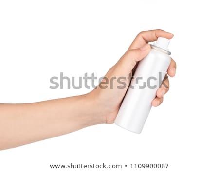 Sun protection spray on white background. Stock photo © asturianu