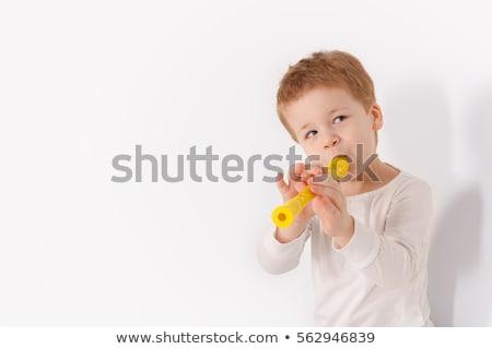 young boy playing recorder stock photo © freshdmedia