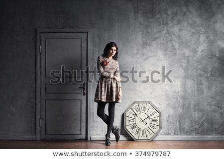 Beautiful woman posing with a timepiece Stock photo © stockyimages