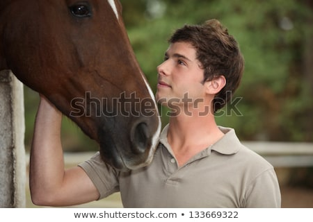 Man stood by brown horse Stock photo © photography33