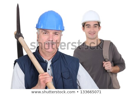 mature manual worker and young apprentice in background Stock photo © photography33
