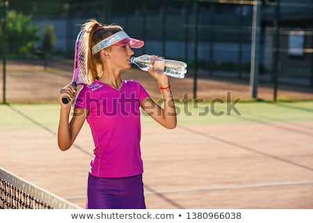 Tennis player drinking bottled water Stock photo © photography33