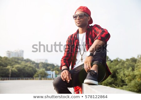 Serious man sitting against a tree Stock photo © photography33