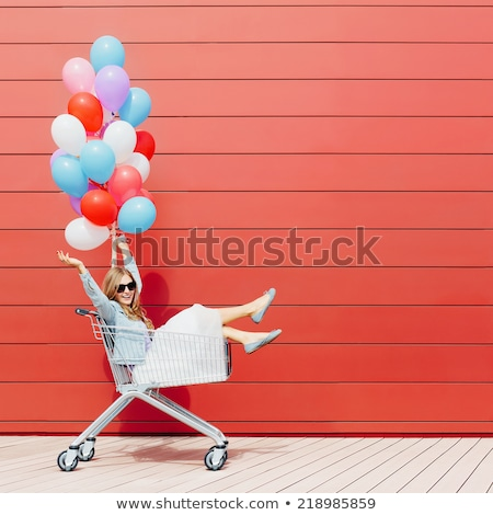 happy girl with colorful balloons stock photo © dolgachov