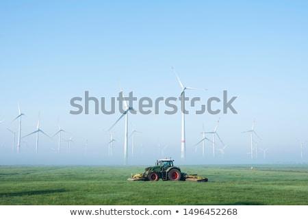 Landscape with fields and tractor near wind generators Stock photo © krabata