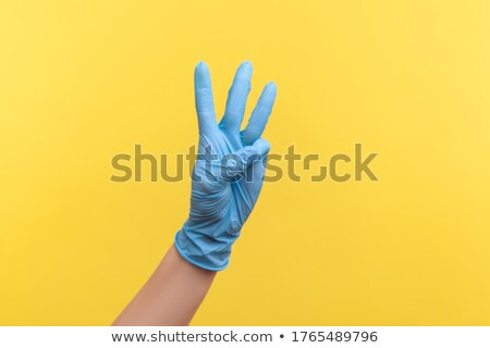 Woman hand showing three count Stock photo © stockyimages