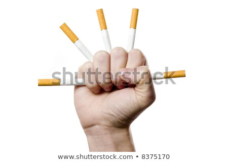 Homme poing piercing cigarettes noir fond Photo stock © AndreyPopov