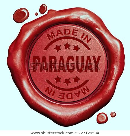made in paraguay   stamp on red wax seal stock photo © tashatuvango