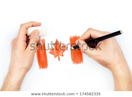 Man's hands with pencil draws flag of Canada on white Stock photo © vlad_star