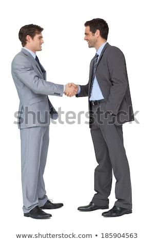 Vista lateral caucasiano empresário apertar a mão isolado Foto stock © dgilder