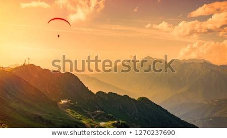 Hegyek felhős égbolt tájkép repülőgép felhő Stock fotó © amok