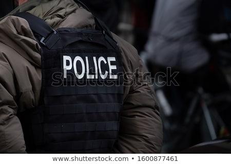 Takım subay beyaz yalıtılmış siyah güç Stok fotoğraf © shivanetua