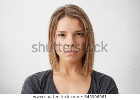Pretty young girl with a look of disbelief Stock photo © stryjek