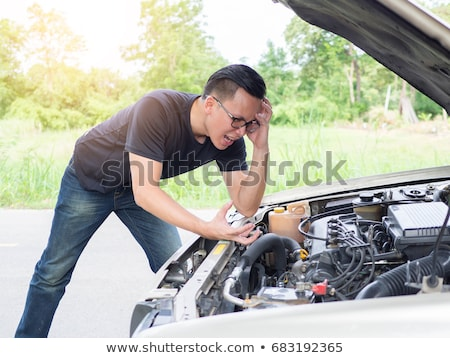 Photo stock: Driver Furious A Broken Car By The Road