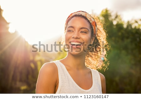 Portrait of a happy woman looking away Stock photo © deandrobot
