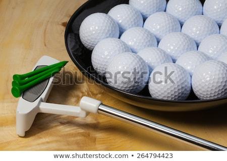 Black ceramic bowl full of white golf balls Stock photo © CaptureLight