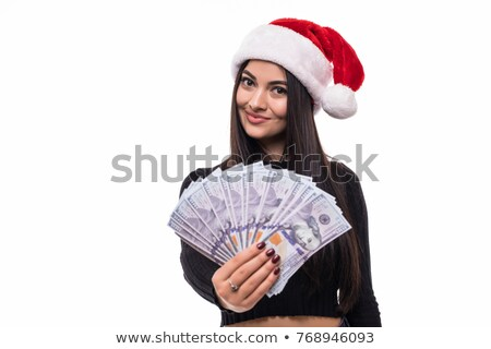 festive brunette in red dress showing her cash stock photo © wavebreak_media
