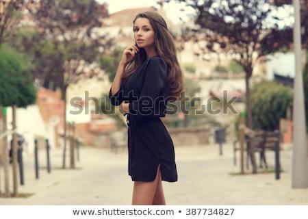 ritratto · bella · pensieroso · donna · vestito · nero · piedi - foto d'archivio © deandrobot