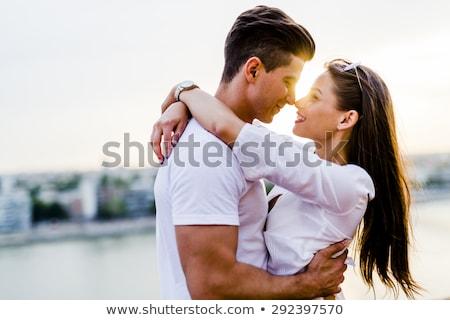 Happy romantic couple hugging Stock photo © deandrobot