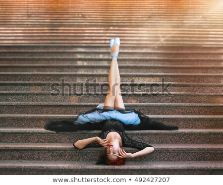 Young Beautiful Ballerina Posing On The Stairs Stock photo © d13