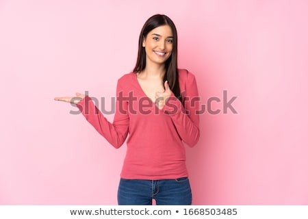 Happy woman holding copyspace on the palm Stock photo © deandrobot