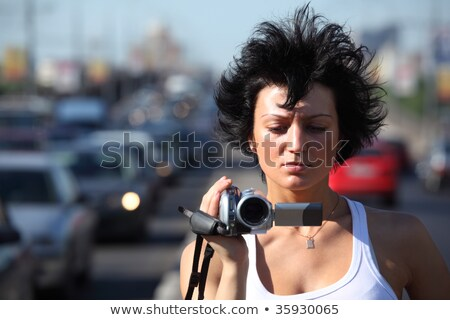 girl with videocamera on highway Stock photo © Paha_L