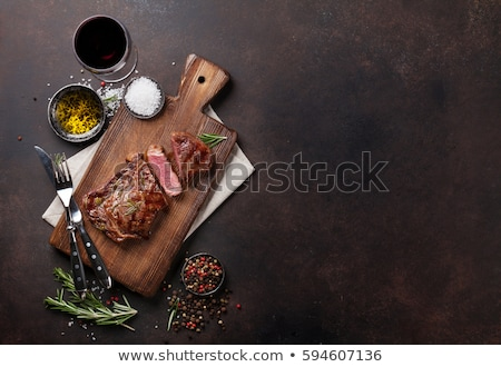 Grilled beef steak with rosemary, salt and pepper and wine Stock photo © karandaev