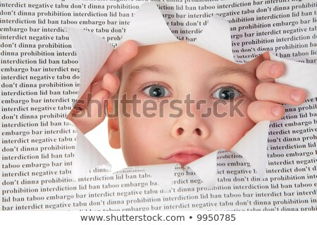 boy looks into the hole in the sheet of paper with the text Stock photo © Paha_L