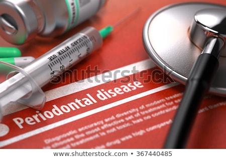 periodontal disease   printed diagnosis on orange background stock photo © tashatuvango
