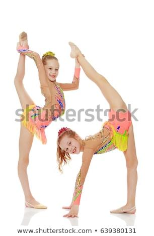 Happy ballerina doing splits Stock photo © deandrobot