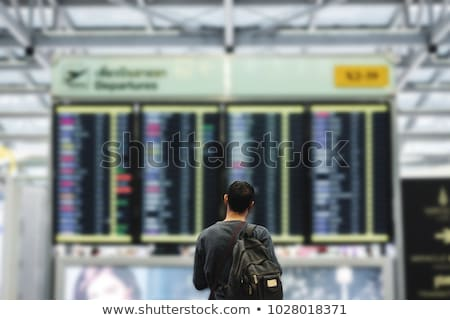 Man looking at departure board. Stock photo © RAStudio
