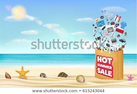 hot summer sale in orange label over sea background stock photo © marinini