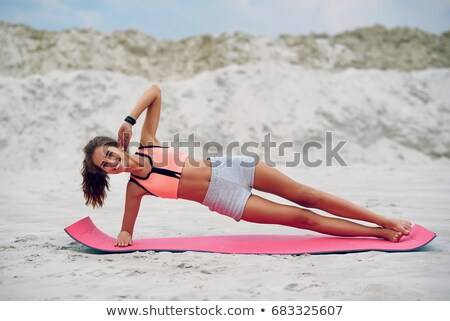 Woman in plank yoga pose meditating at sunset. Zen Stock photo © photocreo
