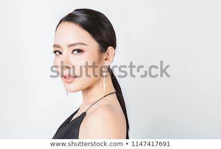 Belo jovem asiático mulher diamante brinco Foto stock © dolgachov