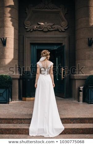 Elegant lady. Beautiful bride in gorgeous wedding dress posing o Stock photo © Victoria_Andreas