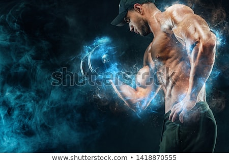 Bodybuilder with dumbbells in studio Stock photo © deandrobot