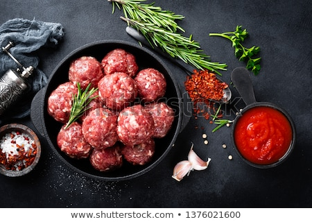 Stock photo: raw meatballs and garlic