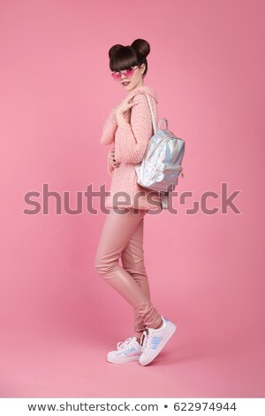 Fashion style teen look. Fashionable young girl wears in wool sw Stock photo © Victoria_Andreas