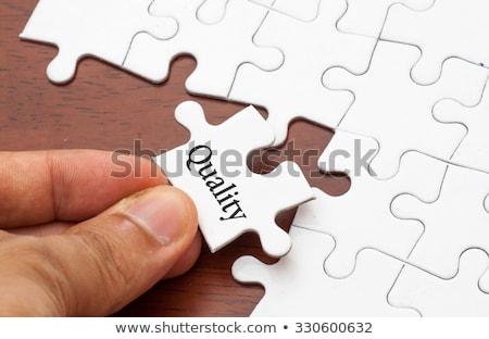 performance   puzzle on the place of missing pieces stock photo © tashatuvango
