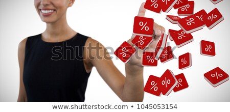 happy businesswoman looking away while touching invisible interface stock photo © wavebreak_media