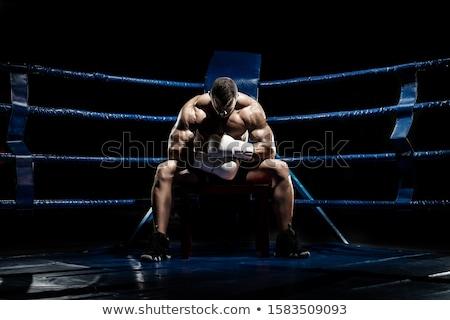 Jovem forte boxeador treinamento boxe anel Foto stock © deandrobot