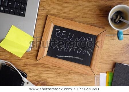 customer on chalkboard in the office stock photo © tashatuvango