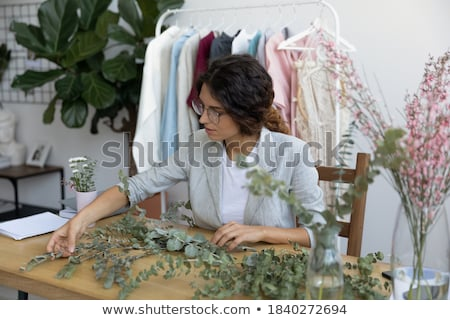 Woman standing in sunny home office Stock photo © IS2