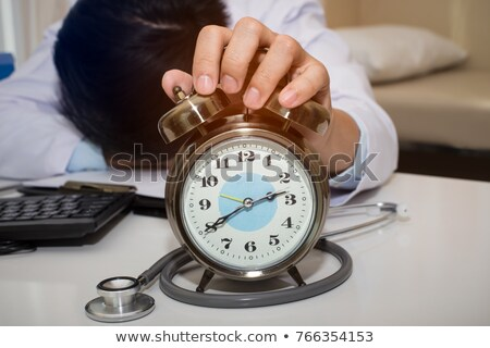 male doctor working at desk at night stock photo © is2