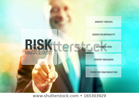Foto d'archivio: Hand Finger Press Risk Management Button