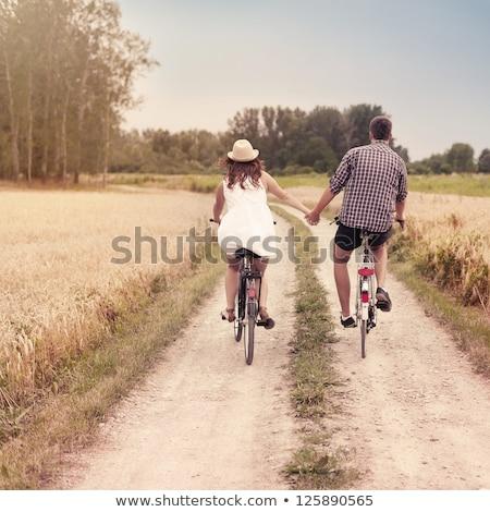 пару · , · держась · за · руки · далеко · цветок · семьи - Сток-фото © is2