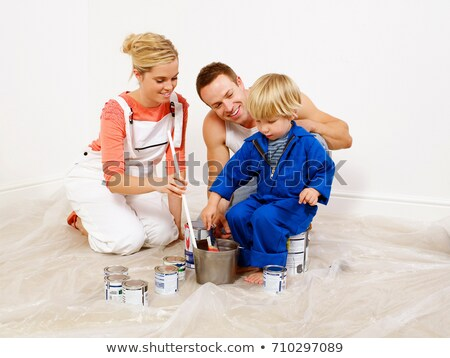 Couple and boy mixing paint in bucket Stock photo © IS2