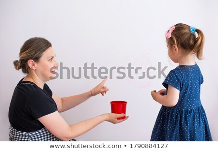 Messy children pointing at girl Stock photo © IS2