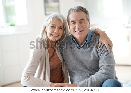 Senior couple sitting on a couch Stock photo © IS2