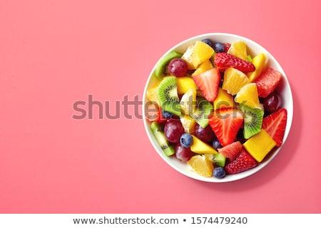 Bol salade de fruits fruits déjeuner blanche dessert Photo stock © M-studio